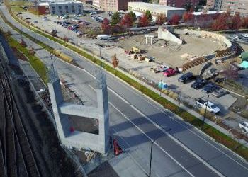 Work on U-District pedestrian bridge stops for season