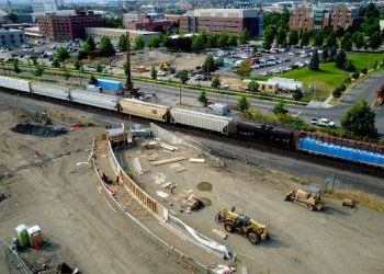 Pedestrian bridge rises in Spokane's University District